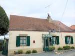Une maison avec garage et beau jardin a vendre dans la Creuse, region Limousin pres d'Aigurande