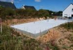 Terrain constructible avec dalle beton en place.
