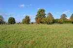 Terrain plat constructible1000 m2 hors lotissement.