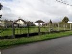 Terrain constructible de 976 m2, cloturé avec barrière