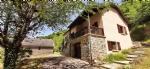 CONQUES :Maison + grange en pierre du pays sur grand terrain boisé de plus de 4 hectares