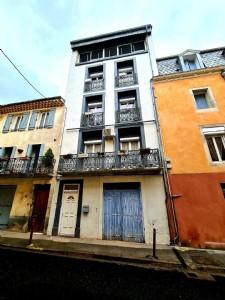 Maison de ville de 220 m² habitables avec grand séjour, 5 chambres, garage et caractère !